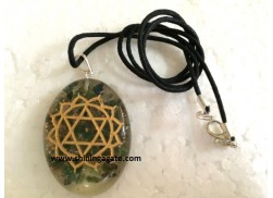 GREEN AVENTURINE CHAKRA ENGRAVED ORGONE OVAL PENDANT WITH CORD