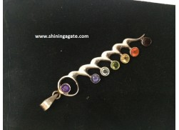 CHAKRA METAL PENDANT WITH CURVES